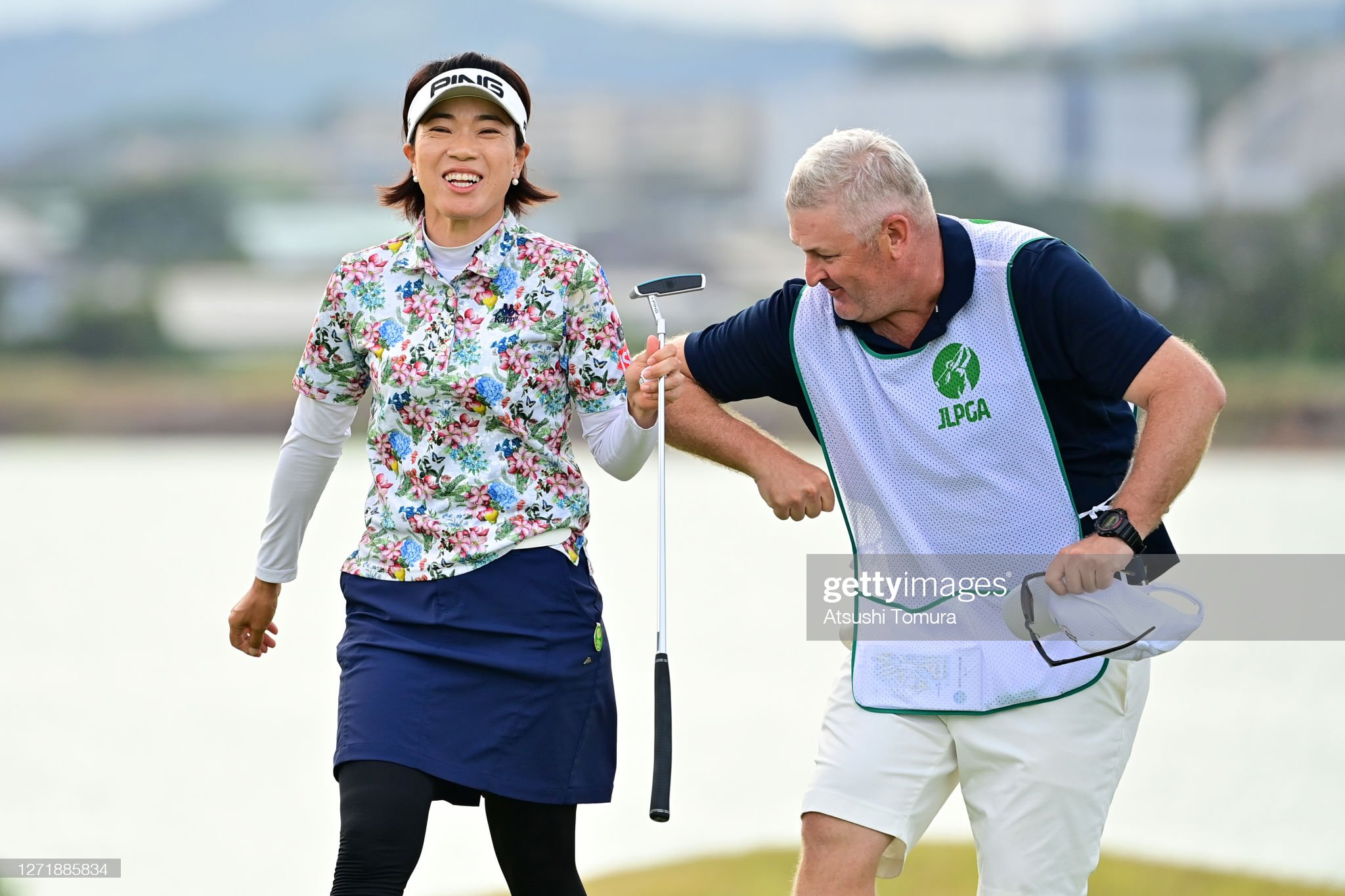 https://media.gettyimages.com/photos/shiho-oyama-of-japan-elbow-bumps-with-her-caddie-after-the-birdie-on-picture-id1271885834?s=2048x2048
