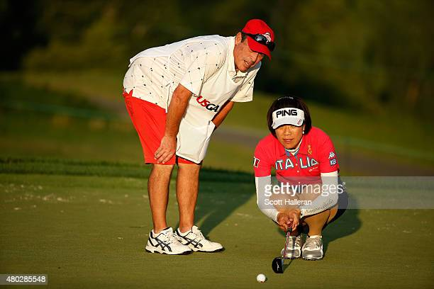 Shiho Oyama of Japan lines up putt with her caddie Dana Derouaux on the ninth green during the second round of the US Women's Open at Lancaster...