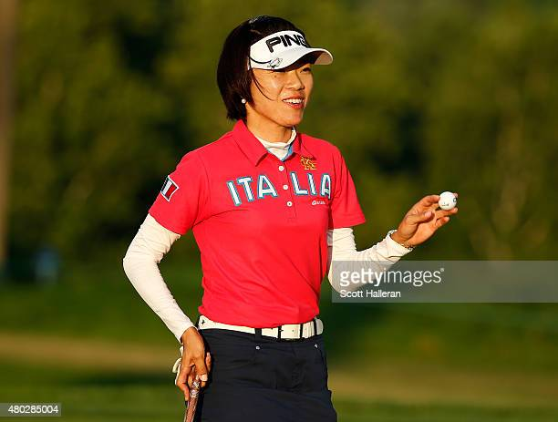 Shiho Oyama of Japan waves to the gallery on the ninth green during the second round of the US Women's Open at Lancaster Country Club on July 10 2015...