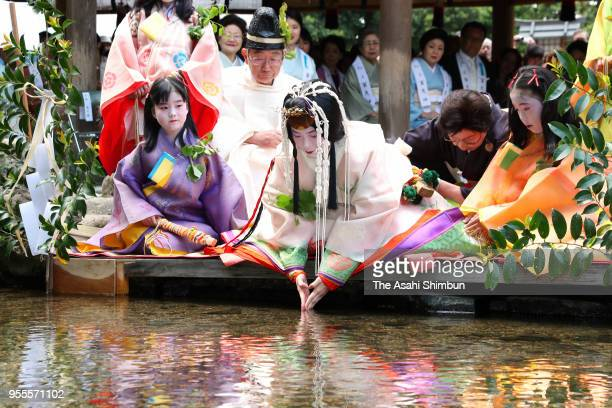 Shiho Sakashita the Saiodai for this year's Aoi Festival dips her fingers into the Mitarashigawa river that flows through Kamigamo Jinja Shrine on...