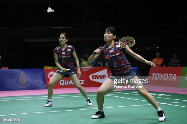 Shiho Tanaka and Koharu Yonemoto of Japan compete against Anne Julie Beaulieu and Stephanie Pakenham of Canada during Preliminary Round on day two of...