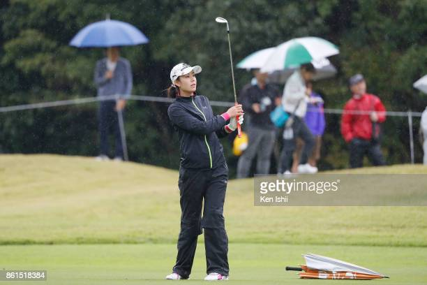 Shiho Toyonaga of Japan watches her shot on the 18th hole during the final round of the Udonken Ladies at the Mannou Hills Country Club on October 15...