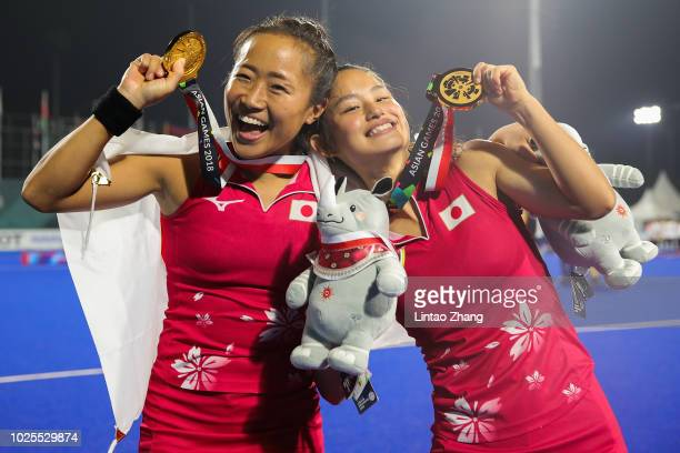 Shihori Oikawa and Aki Yamada of Japan celebrate during the medal ceremony for the Hockey Women's Tournament Final match between Japan and India on...