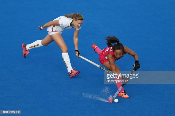 Shihori Oikawa of Japan is chased by AnneSophie Weyns of Belgium during the Pool D game between Japan and Belgium of the FIH Womens Hockey World Cup...