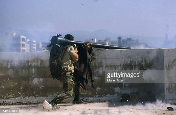 "Shi'ite Amal Militiaman fires a 75mm gun at the Bourj El Barajneh Palestinian Camp. The ""War of Factions"" started by Shi'ite Amal Militia opposed to..."