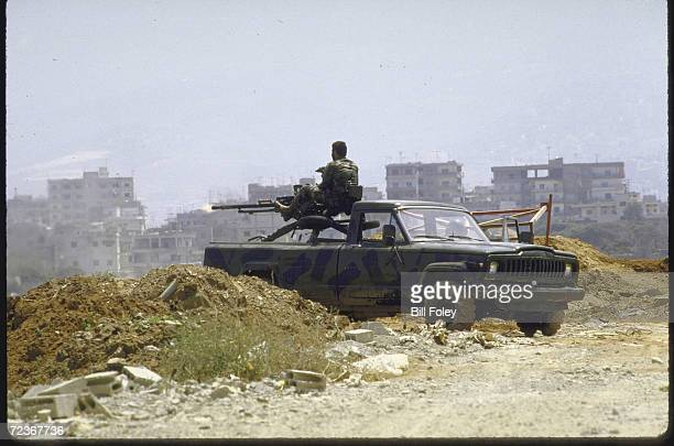 Shiite Amal militiamen fire antiaircraft gun into Sabra camp during battle with Palestinian fighters