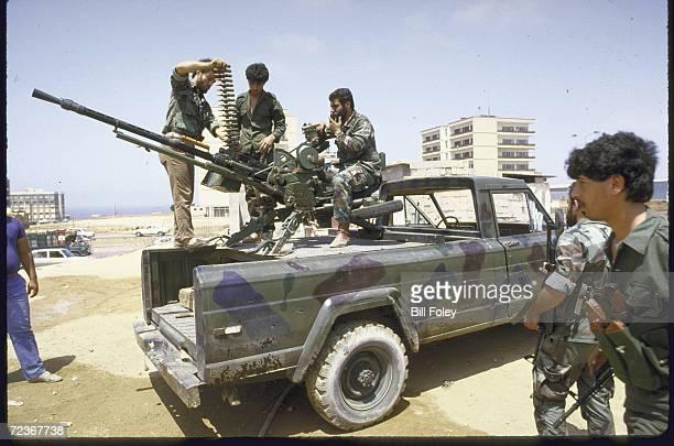 Shiite Amal militiamen loading rounds into clips