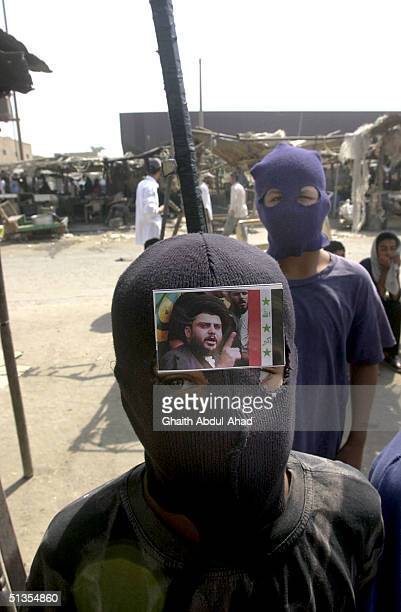 Shiite boys wearing ski masks brandish wooden sticks made to look like RPG launchers as thousands of Iraqi Shiites loyal to the radical cleric...
