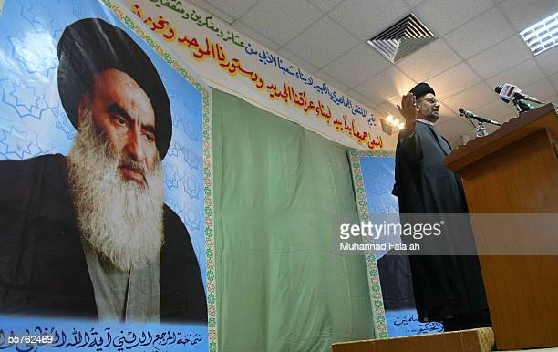 Shiite cleric Abdul-Aziz al-Hakim, head of the Supreme Council for the Islamic Revolution in Iraq , a main Shiite political party, talks to...