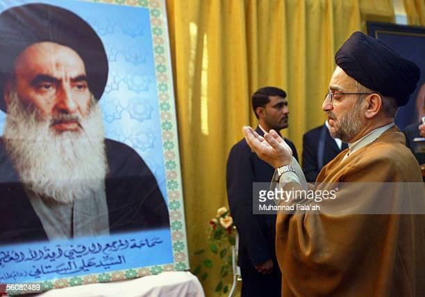 Shiite cleric Abdul-Aziz al-Hakim, head of the Supreme Council for the Islamic Revolution in Iraq , a main Shiite political party, attends the prayer...