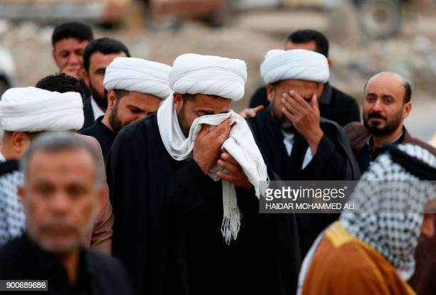 Shiite clerics and members of the Hashed alShaabi mourn the death of a religious member of their community Sheikh Mohannad alMayahi who died of his...