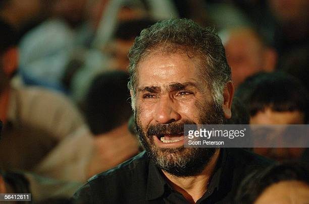 Shiite devotee cries during prayers at the Jamkaran Mosque December 6 2005 in Jamkaran Iran Some Iranian Shiites believe and are waiting for the...