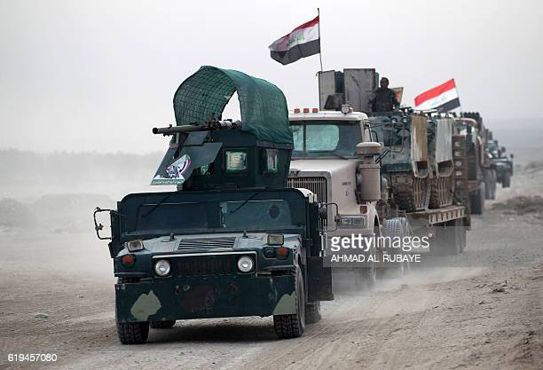 Shiite fighters from the Hashed alShaabi drive their vehicles towards the village of Umm Sijan south of Mosul on October 31 2016 during Iraqi forces'...