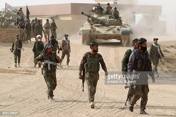 Shiite fighters from the Hashed al-Shaabi enter the village of Abu Shuwayhah, south of jihadist-held Mosul, on November 1 during the ongoing...