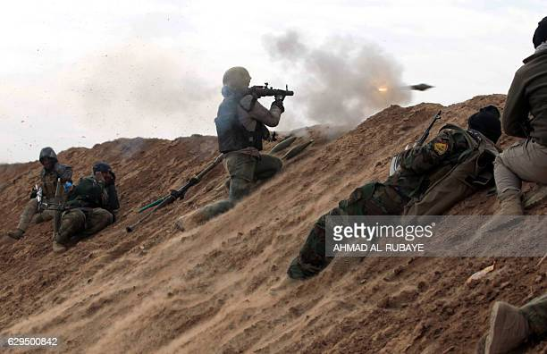 TOPSHOT Shiite fighters from the Hashed alShaabi paramilitary units advance towards the village of Shwah south of the city of Tal Afar on the western...