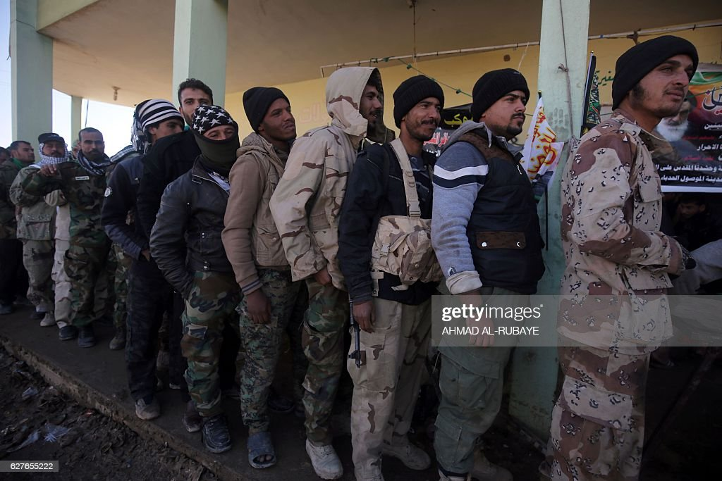 Shiite Fighters From The Hashed AlShaabi Queue Up To Receive Food From  Volunteers Who Cook For