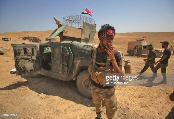 Shiite fighters from the Popular Mobilization Forces advance towards the city of Tal Afar the main remaining stronghold of the Islamic State group...