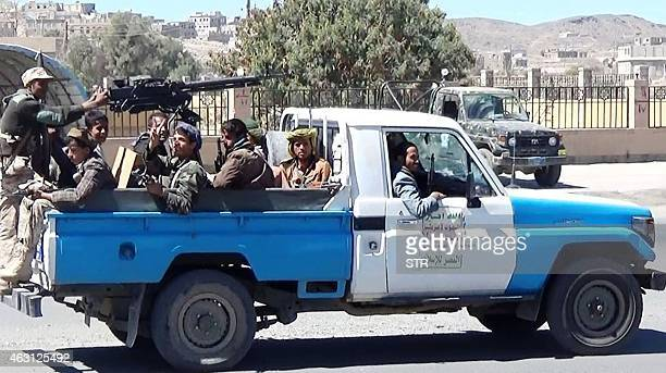 Shiite Huthi fighters loyal to the Republican Guard forces supporting former Yemeni president Ali Abdullah Saleh's are seen in an armed vehicle in...