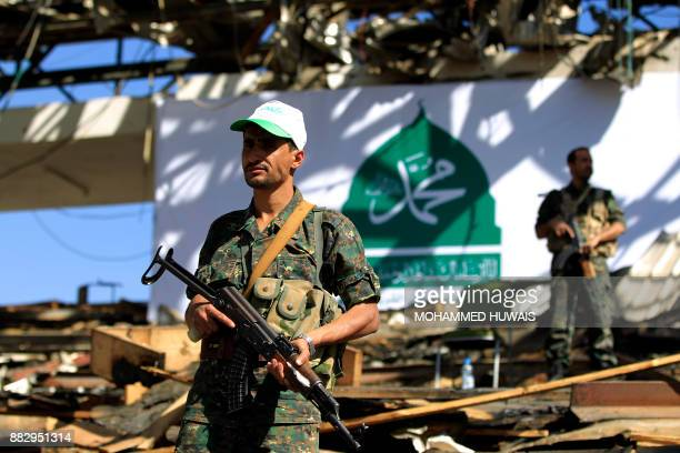 Shiite Huthi rebel fighters stand guard as Muslim Yemenis attend a rally in the capital Sanaa on the occasion of the Prophet Mohammed's birthday on...
