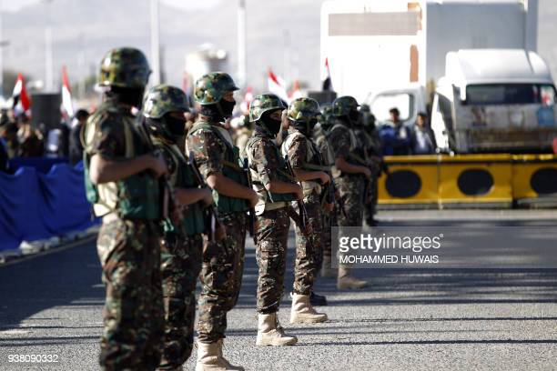 Shiite Huthi rebel fighters stand guard during a rally to mark three years of war on the country in the capital Sanaa on March 26 2018 A Saudiled...