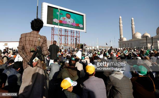 TOPSHOT Shiite Huthi rebels and their supporters watch on a big screen a live speech given by leader AbdulMalik alHuthi as they attend a rally...
