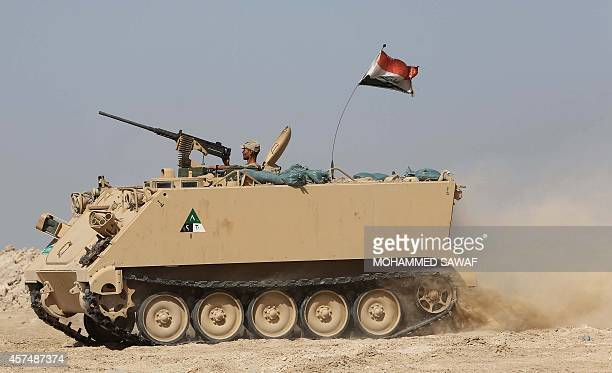 Shiite Iraqi fighter, loyal to Grand Ayatollah Ali al-Sistani, positions an armored personnel carrier during clashes with Islamic State militant...