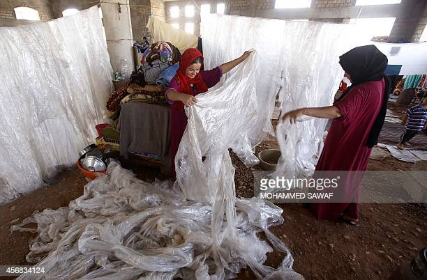 Shiite Iraqi Kurdish women known as 'Shabak' displaced by fierce fighting between Kurdish peshmerga forces and jihadist militants from the Islamic...