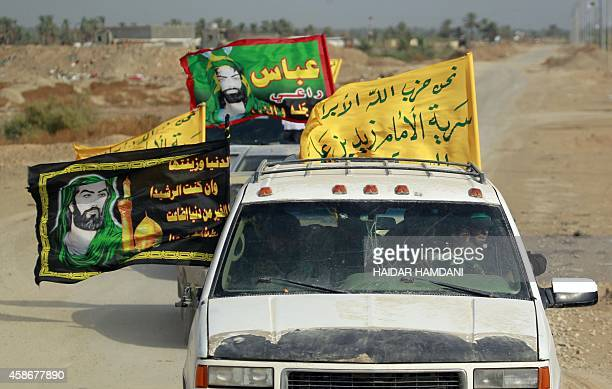Shiite members of Iraqi progovernment forces drive on a road near the town of Jurf alSakhr located between Baghdad and the shrine city of Karbala on...