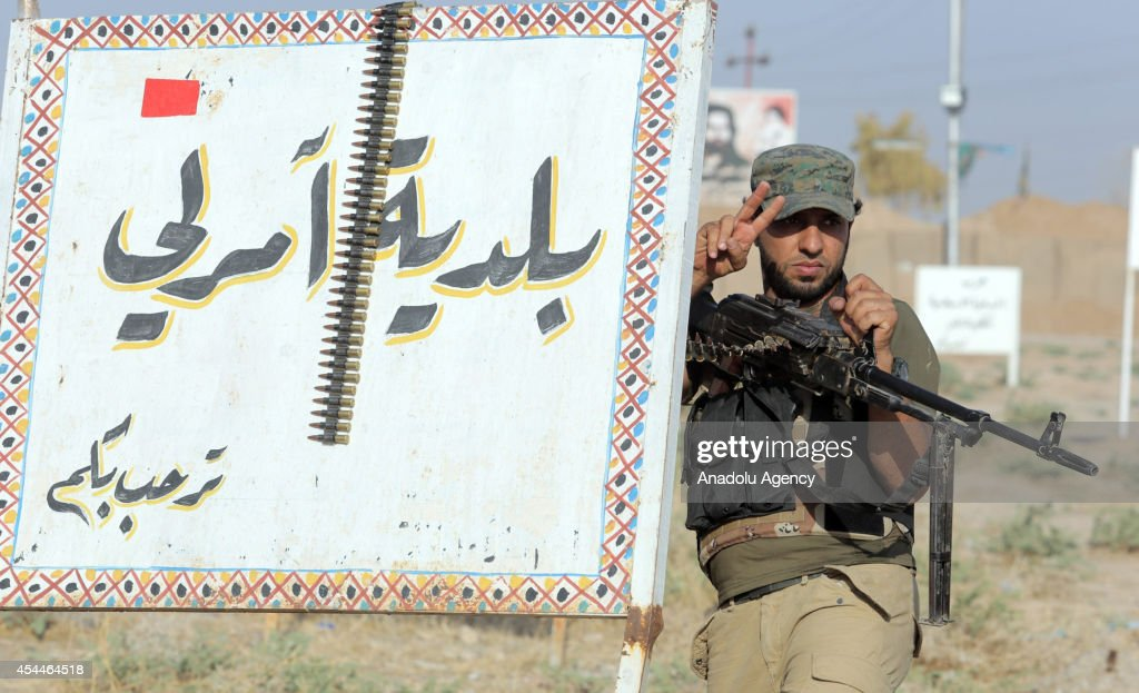 A Shiite militant makes victory sign as he stands guard after Iraqi forces have entered the northern town of Amirli which had been under the siege of Islamic State militants for over two months in Saladin ,Iraq on September1, 2014. Supported by Kurdish forces and Shiite militias, the Iraqi army launched an offensive shortly after the U.S. carried out airstrikes against Islamic State (IS) positions near the town, and dropped aid for the nearly 20,000 Shiite Turkmen trapped in Amirli. The government forces and Kurdish peshmerga forces have been fighting against the militant group to block their advance.