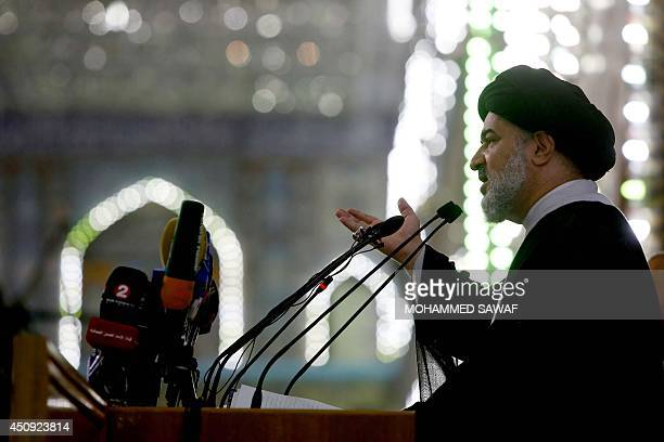 Shiite Muslim Ahmad Safi, the representative of Iraq's Shiite spiritual leader Grand Ayatollah Ali Sistani, gives a sermon at the Imam Hussein mosque...