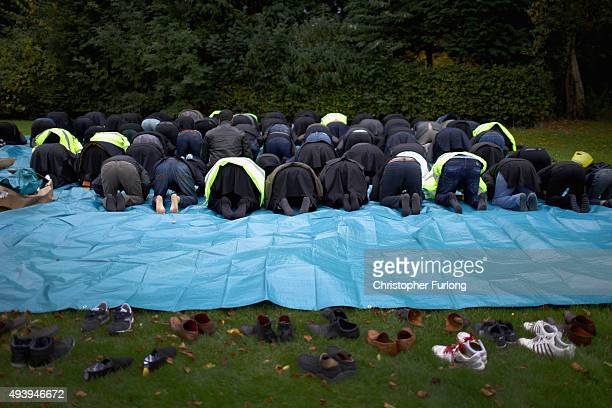 Shiite Muslim devotees pray before they take part in a ritual selfflagellation procession on October 23 2015 in Manchester England Shiites across the...