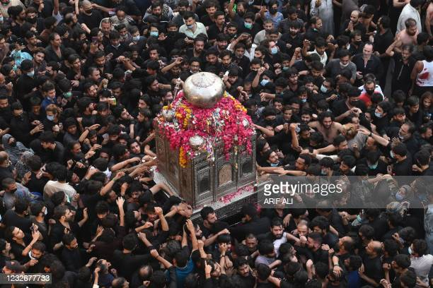 Shiite Muslim devotees take part in a procession to commemorate the death anniversary of Prophet Mohammad's companion and son-in-law Imam Ali in...