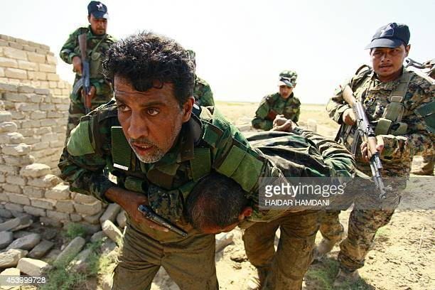 Shiite Muslim fighters, loyal to Iraqi Shiite cleric Moqtada al-Sadr, take part in a last combat training near the city of Najaf on August 23 before...