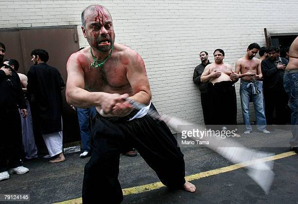 Shi'ite Muslim flagellates himself during a procession marking the festival of Ashura outside the alKhoei Islamic Center January 19 2008 in the...