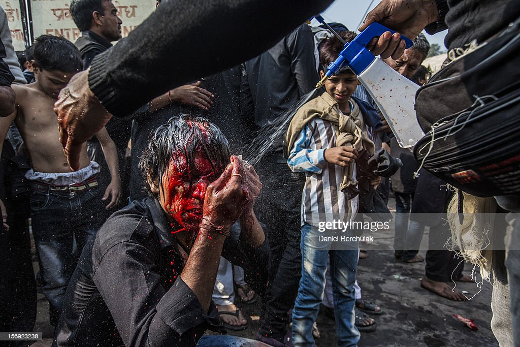 A Shiite Muslim man has water sprayed onto him after having cut himself as part of a self-flagellation ritual during a religious procession marking Ashura on November 25, 2012 in New Delhi, India. The religious festival of Ashura, which involves a ten-day mourning period starting with the first day of Muharram on the Islamic calendar, commemorates and mourns the seventh-century martyrdom of Prophet Muhammad's grandson Imam Hussein in the battle of Karbala.