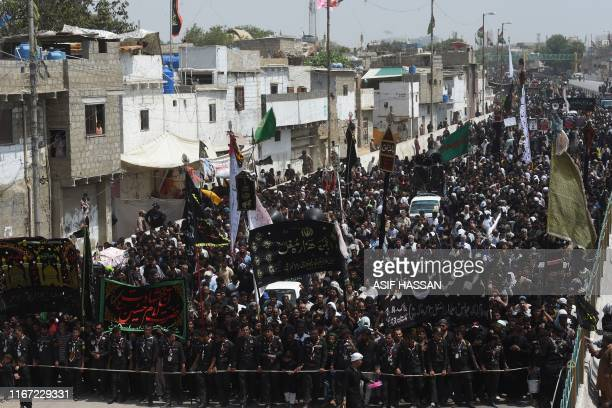Shiite Muslim march during a procession on the tenth day of Muharram, which marks the day of Ashura, in Karachi on September 10, 2019. - Ashura is a...