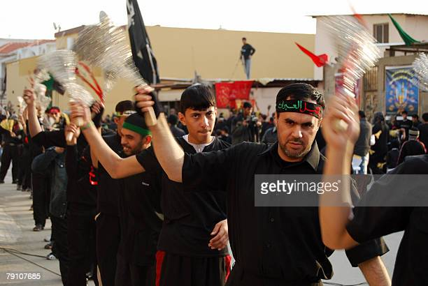Shiite Muslim men flail themselves with chains during a religious procession in the oilrich eastern Saudi city of Qatif 18 January 2008 The world's...