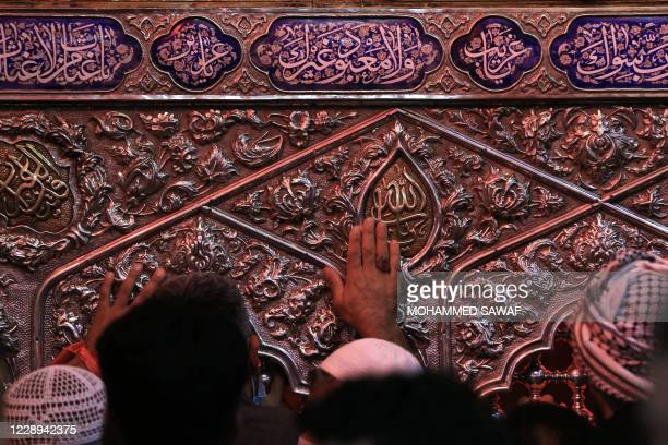 Shiite Muslim men take part in a mourning ritual at the Imam Hussein shrine in Iraq's central holy city of Karbala, on October 7 a day ahead of...