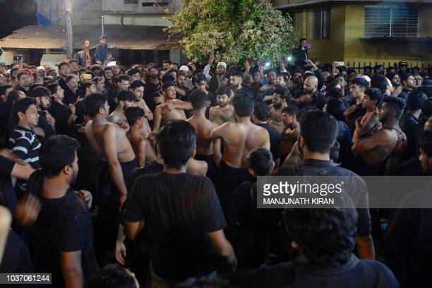 Shiite Muslim mourners beat their chest during a flagellation ritual held to mark Ashura the 10th day of the Islamic month of Muharram in the early...