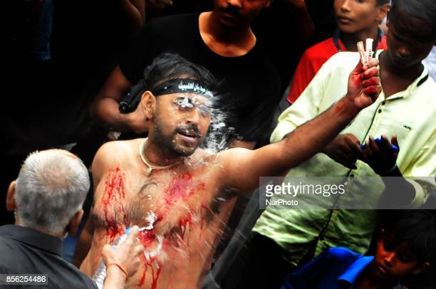 Shi'ite Muslim mourners beat their chests during a Muharram procession to mark Ashura in Kolkata India October 1 2017