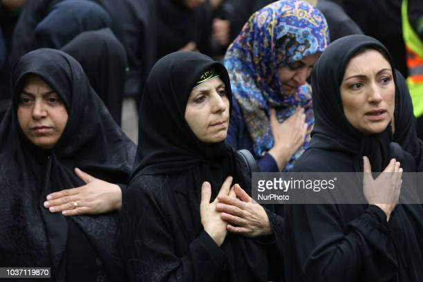 Shiite Muslim mourners take part in a Muharram procession in Toronto, Ontario, Canada, on September 20, 2018. Hundreds of Shiite Muslims took to the...