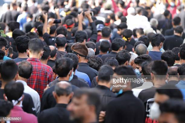 Shiite Muslim mourners take part in the Muharram Processions during the Islamic month of Muharram ahead of Ashura ceremonies, in Baramulla, Jammu and...