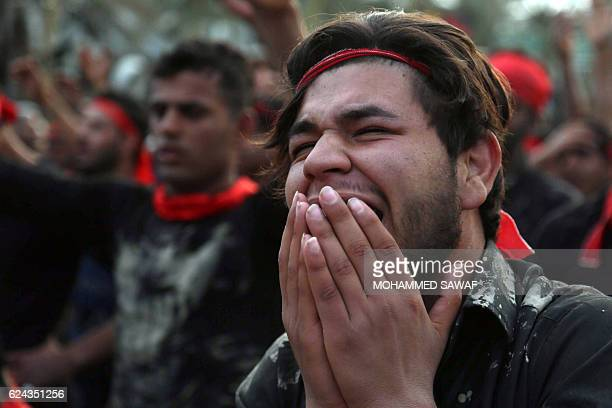 A Shiite Muslim pilgrim cries during a mouring procession on November 19 in the central Iraqi city of Karbala 120 kms south of the capital Baghdad...