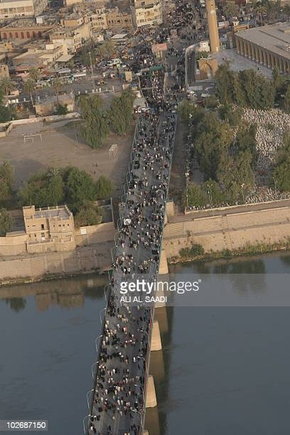 Shiite Muslim pilgrims cross the Tigris River from the Sunni Adhamiyah neighborhood of Baghdad on their way to the Imam Musa alKadhim Mosque in the...