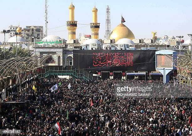 Shiite Muslim pilgrims gather along the walk way between the Imam Hussein Shrine and the Imam Abbas shrine on December 3 in the central Iraqi city of...