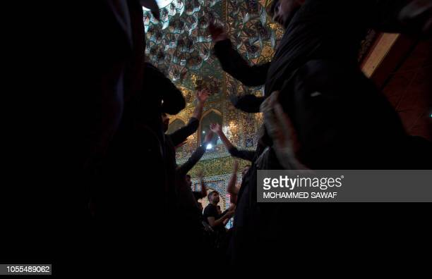 TOPSHOT Shiite Muslim pilgrims gather at the shrine of Imam alAbbas in the central Iraqi holy city of Karbala on October 30 during the Arbaeen...