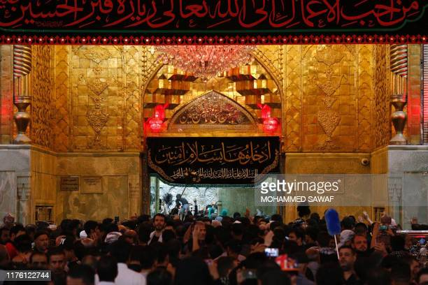Shiite Muslim pilgrims gather for prayers at the shrine of Prophet Mohammed's grandson Imam Hussein in the holy Iraqi city of Karbala south of...