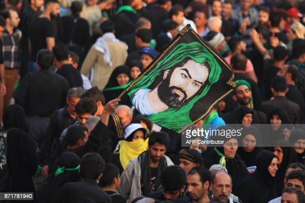 Shiite Muslim pilgrims gather in the southern Iraqi city of Karbala on November 8 2017 ahead of the Arbaeen religious festival which marks the 40th...