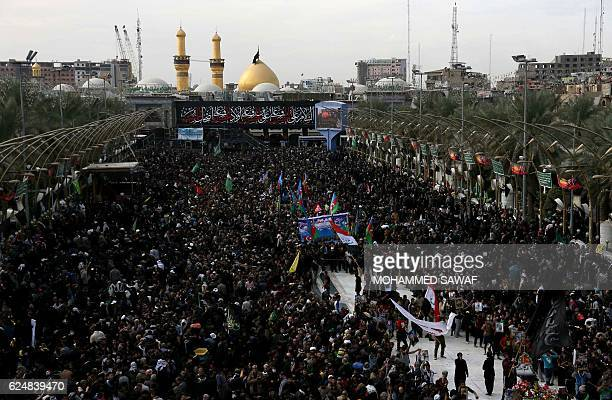 Shiite Muslim pilgrims gather outside the Imam Hussein shrine on the last day of the Arbaeen religious festival on November 21 in the holy Iraqi city...