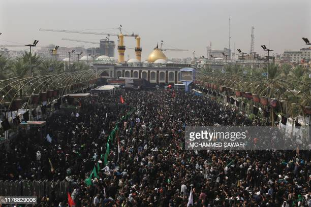 Shiite Muslim pilgrims gather outside the Shrine of Imam Hussein in the holy central Iraqi city of Karbala 100 kilometres south of Baghdad on October...